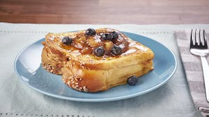 Peanut Butter & Banana Stuffed French Toast with Banana Caramel Sauce Image