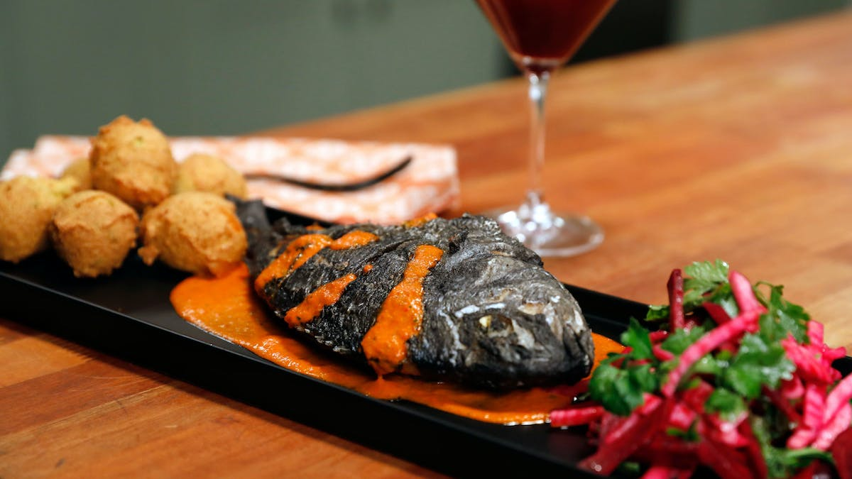 Whole Fried Black Fish with Piquillo Pepper Sauce & Raw Beet Salad Image
