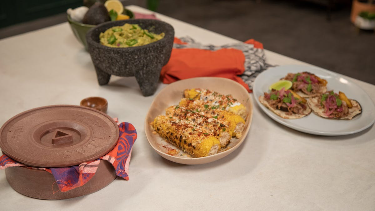 Pernil Tacos with Maduros, Elote and homemade guac Image