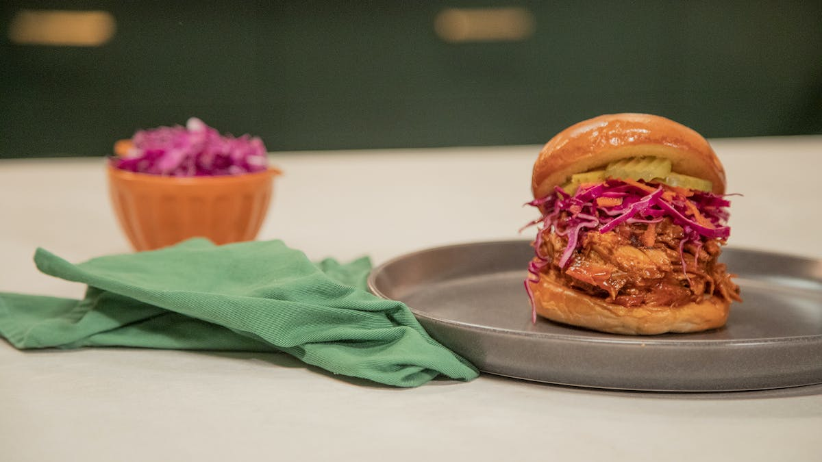 Pulled Pork Sandwich w/ Red Cabbage Coleslaw w/ Dill Pickle Image