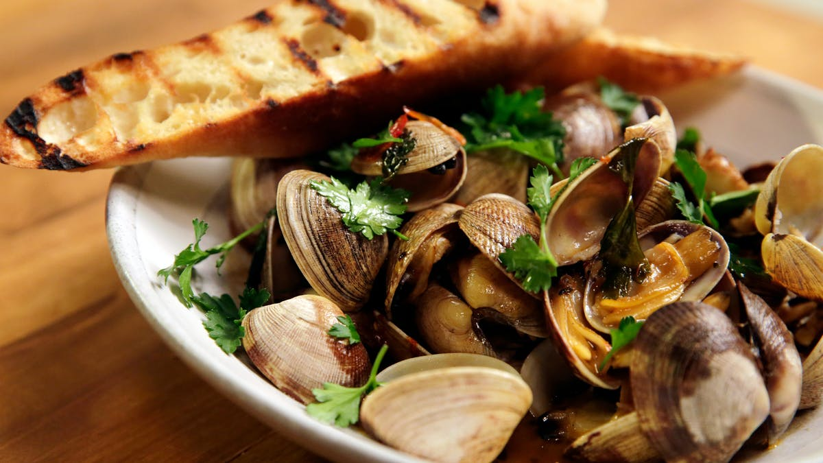 Spicy Italian Clam Bowl with Toasted Baguette Image