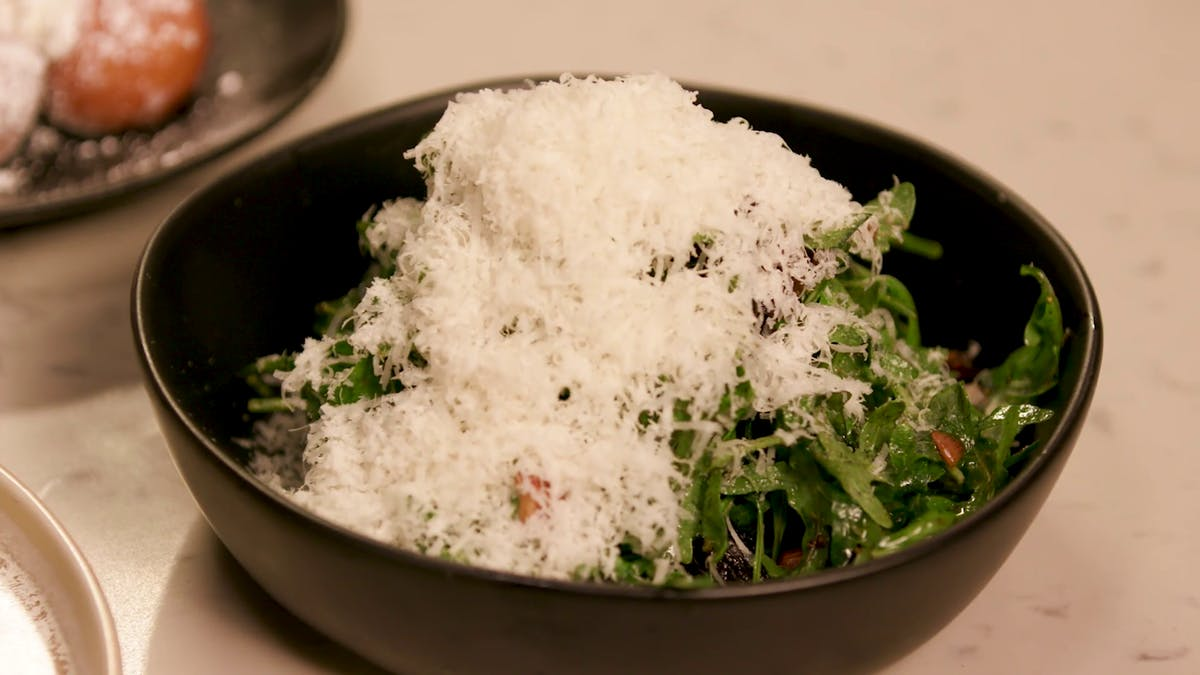 Arugula Salad with Smoked Almonds and Balsamic Fig Vinaigrette Image