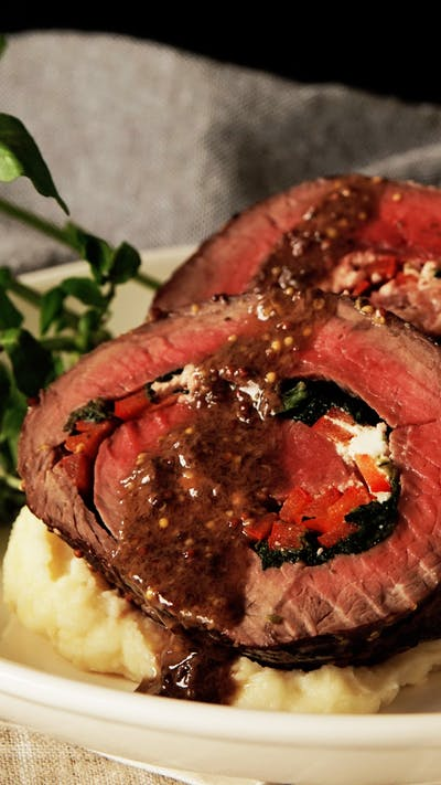 Rolled Roast Beef with Herb Butter