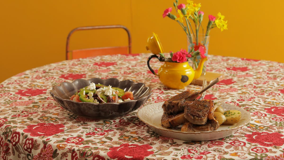 Lamb Chops with Greek Salad and Buttered Potatoes Image