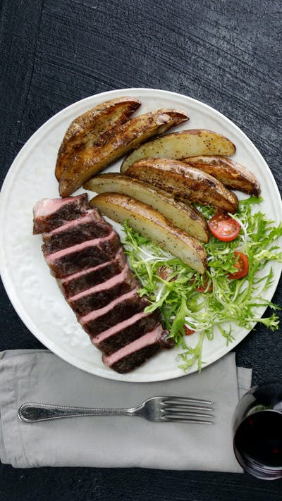 Sheet Pan Steak Frites with Shallot and Thyme Butter