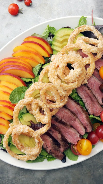 Flank Steak Super Salad with Onion Rings and Onion Dressing