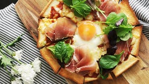 bread-pizza-with-prosciutto-and-baby-greens_landscapeThumbnail_en.png