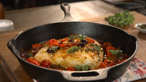 baked-halibut-with-tomatoes-olives-and-white-wine_landscapeThumbnail_en-US.png