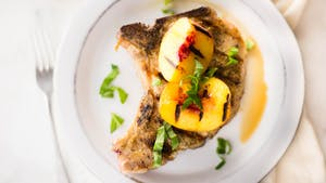 healthy-af_s69e3_grilled-pork-chops-with-spicy-grilled-peaches_landscapeThumbnail_en.jpeg