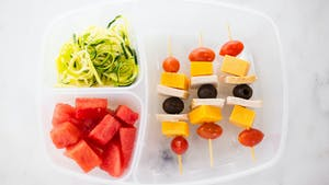 healthy-af_s3e84_meat-and-cheese-skewers-with-a-zucchini-noodle-salad-lunchbox_landscapeThumbnail_en.jpeg