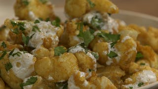 curry-cauliflower-fritters-with-cilantro-yogurt-sauce_landscapeThumbnail_en-US.png