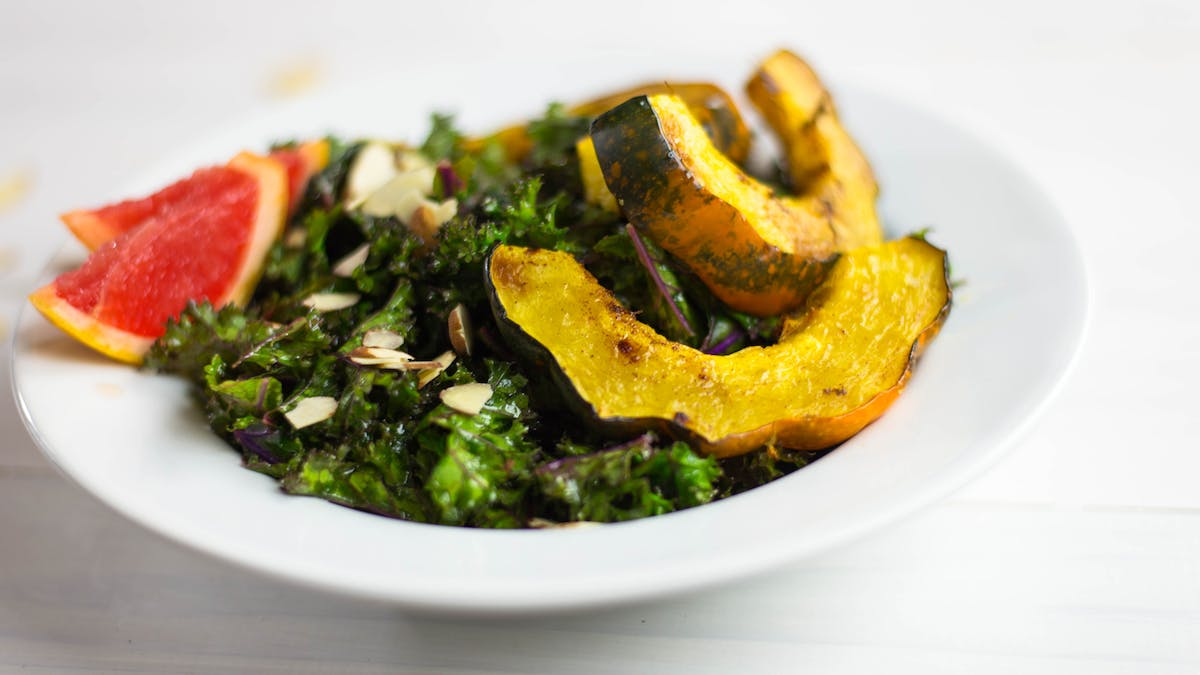 healthy-af_s3e134_roasted-acorn-squash-and-kale-salad_landscapeThumbnail_en.jpeg